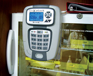 200 / 300 Series temperature monitoring refrigerator / freezer eLock, with wireless 802.11g, HID Prox reader with keypad installed on glass front refrigerator